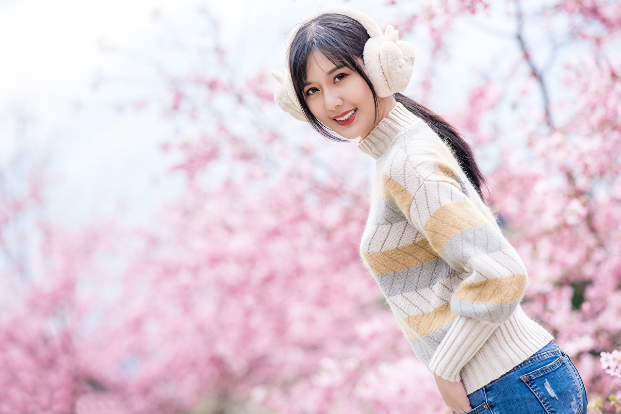 Photo Headphones Brunette girl Smile Bokeh Girls Asian Sweater Staring blurred background female young woman Asiatic Glance