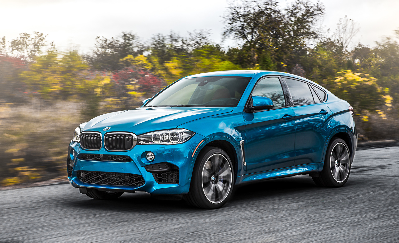 Photo BMW Crossover F86 X6 M Light Blue riding automobile CUV moving Motion driving at speed Cars auto