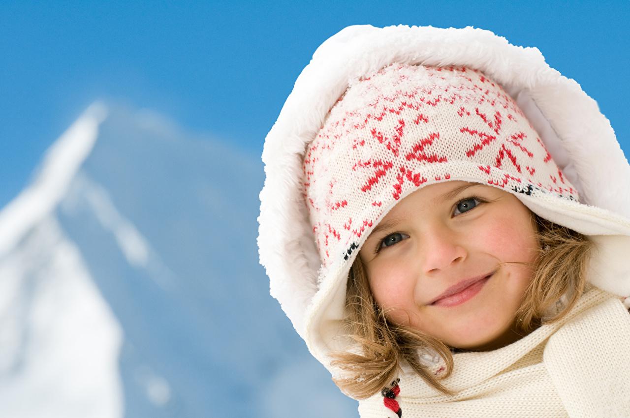 Pictures Little girls Smile child Winter hat Glance hooded Children Staring Hood headgear