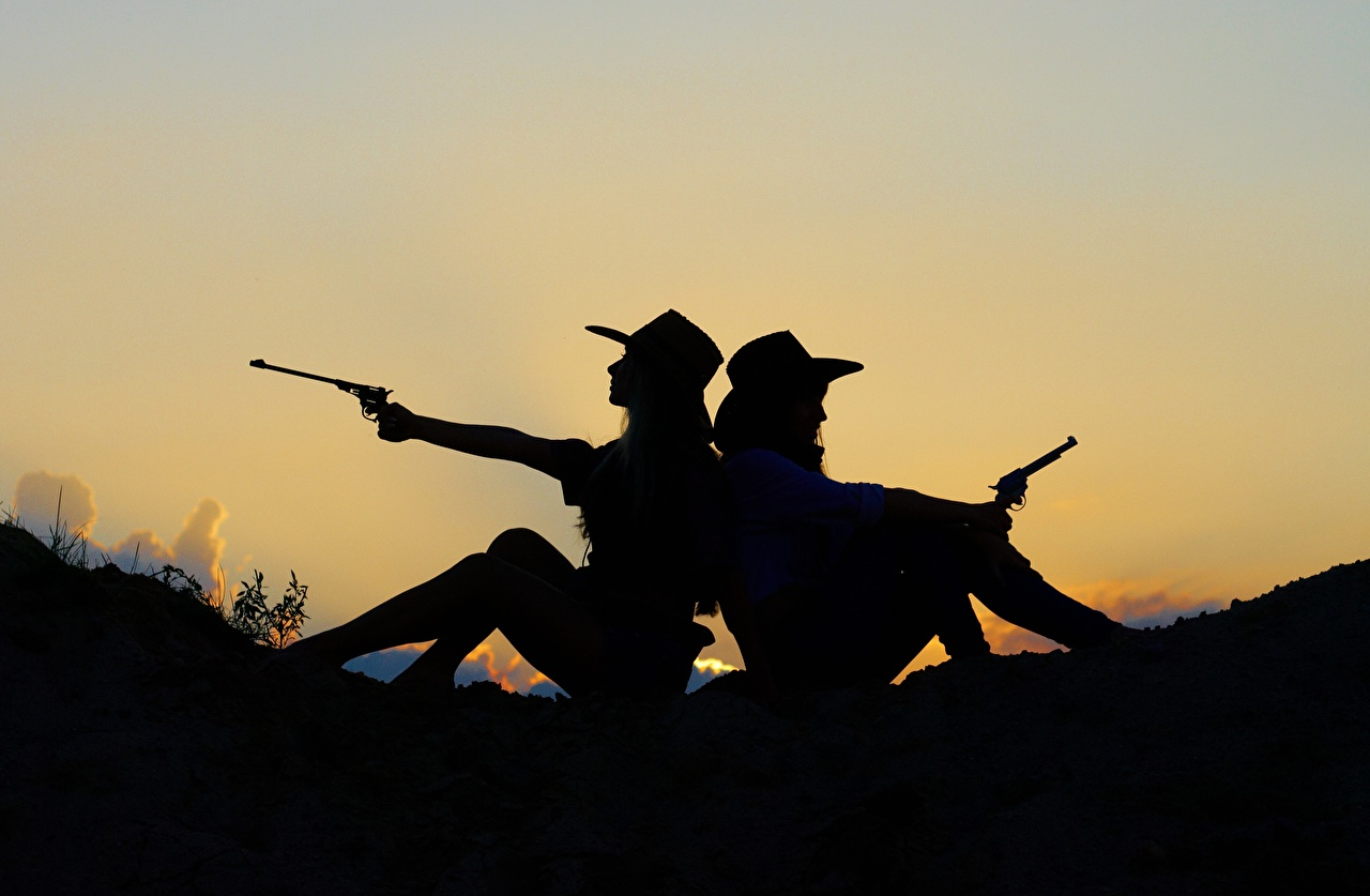 Picture pistol Cowboy Two Hat young woman sunrise and sunset sit Pistols 2 Girls female Sunrises and sunsets Sitting