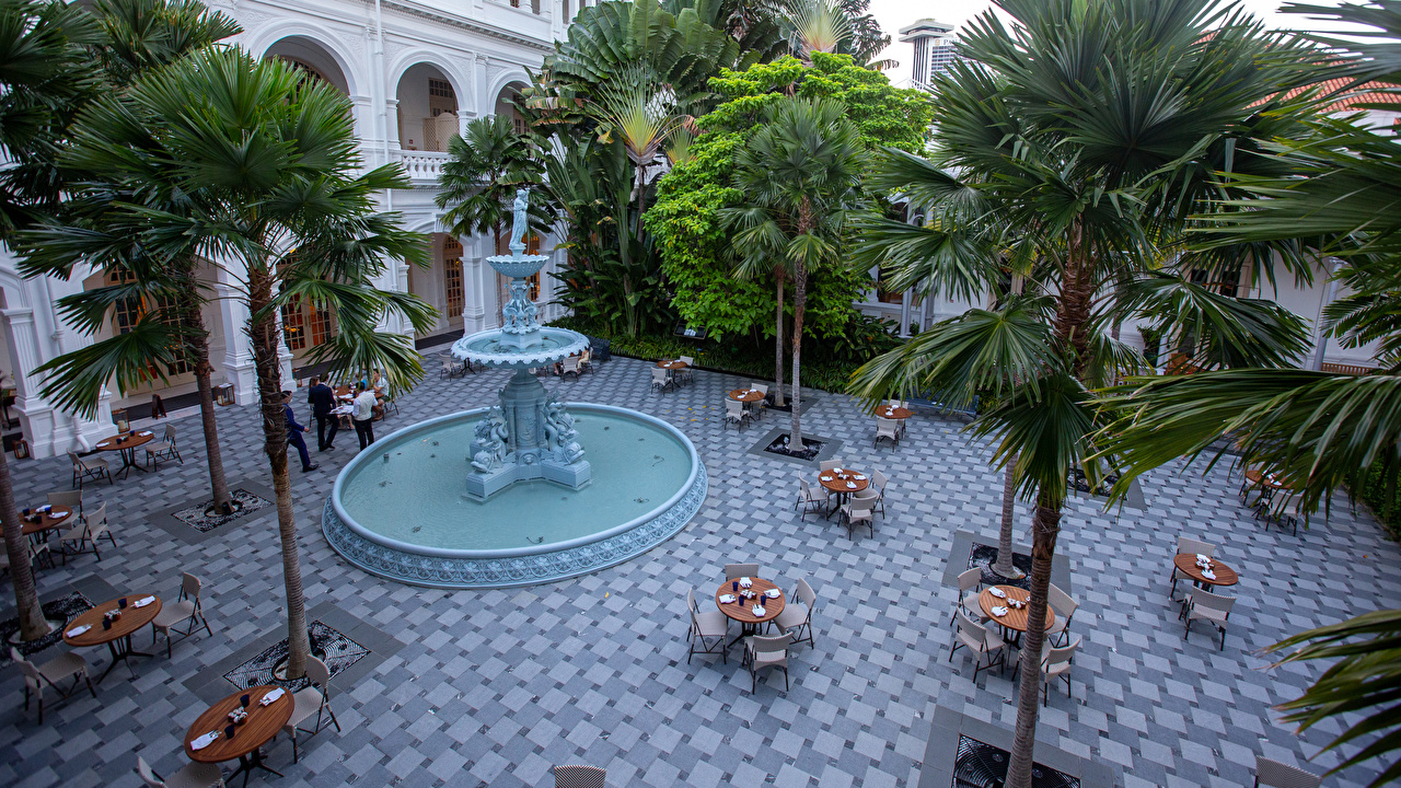 Wallpaper Singapore Fountains Raffles Hotel palm trees Table Chairs Cities Building Sculptures Palms Chair Houses
