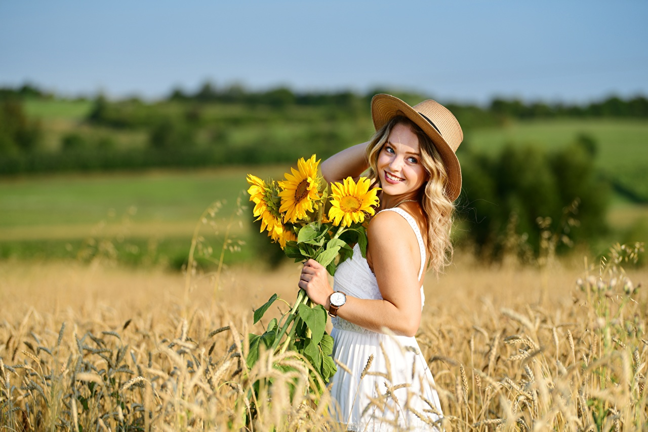 Wallpaper Blonde girl Smile Bokeh Hat Wheat Nature female Fields Sunflowers Dress blurred background Girls young woman Helianthus gown frock