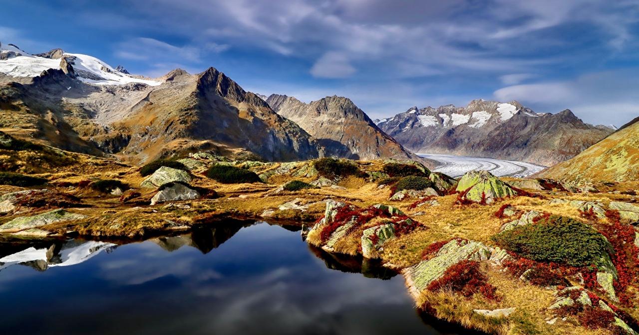 Desktop Wallpapers Alps Switzerland Aletsch Glacier Crag Nature mountain Lake Stones Clouds Rock Cliff Mountains stone