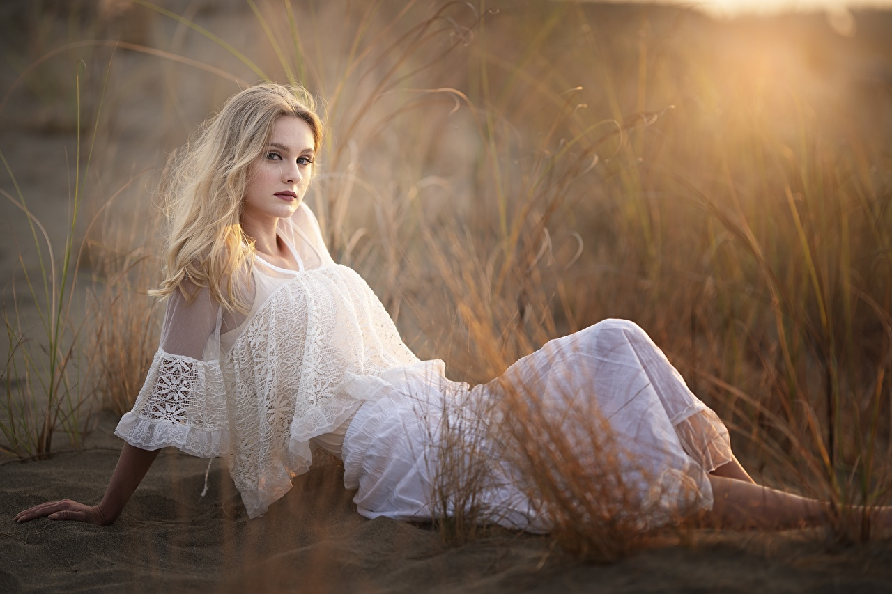 Wallpaper Blonde girl blurred background White female Grass Sitting frock Bokeh Girls young woman sit gown Dress