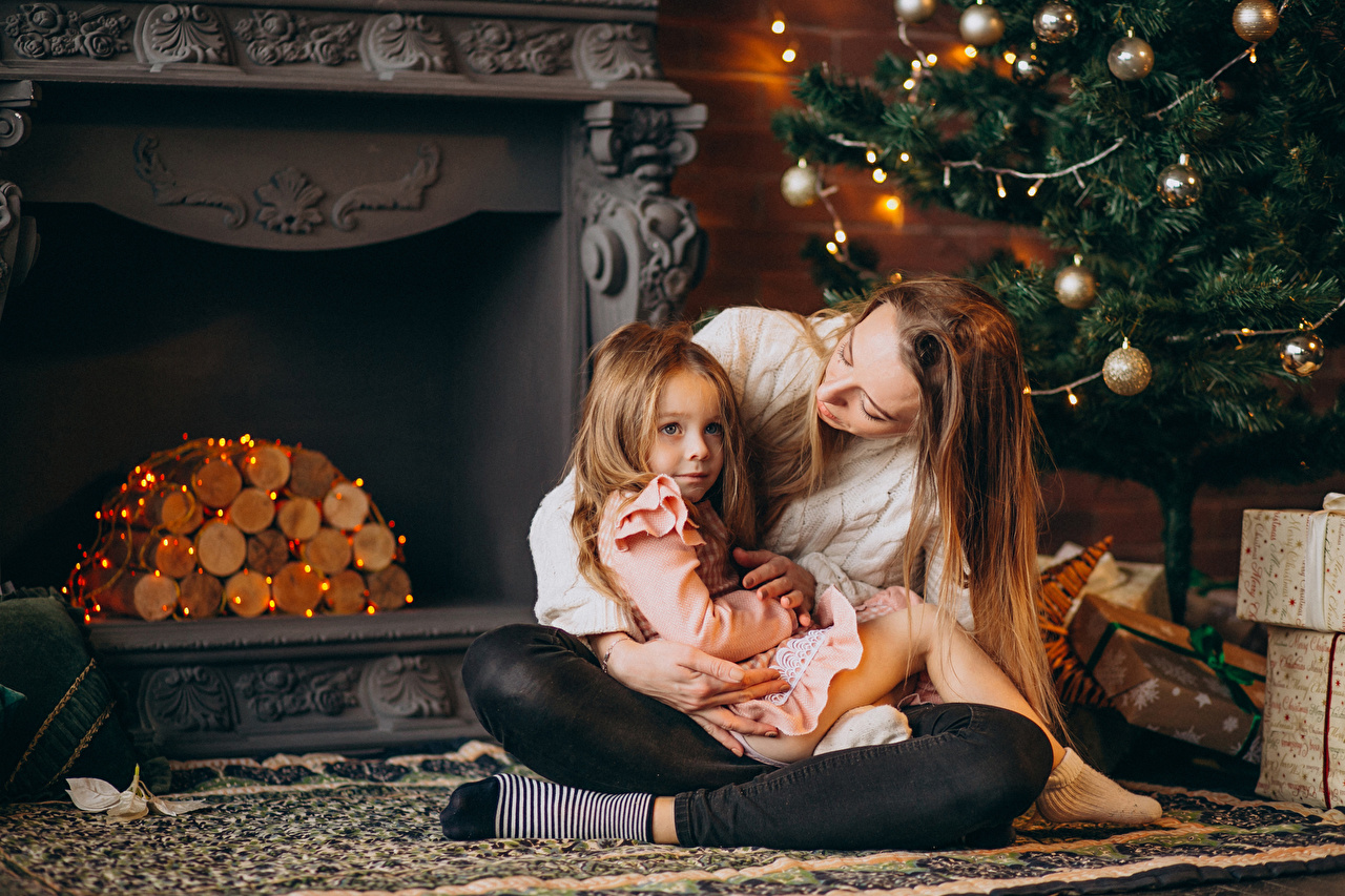 Photo Little girls Christmas Mother Children New Year tree Fireplace sit Fairy lights New year child Christmas tree Sitting