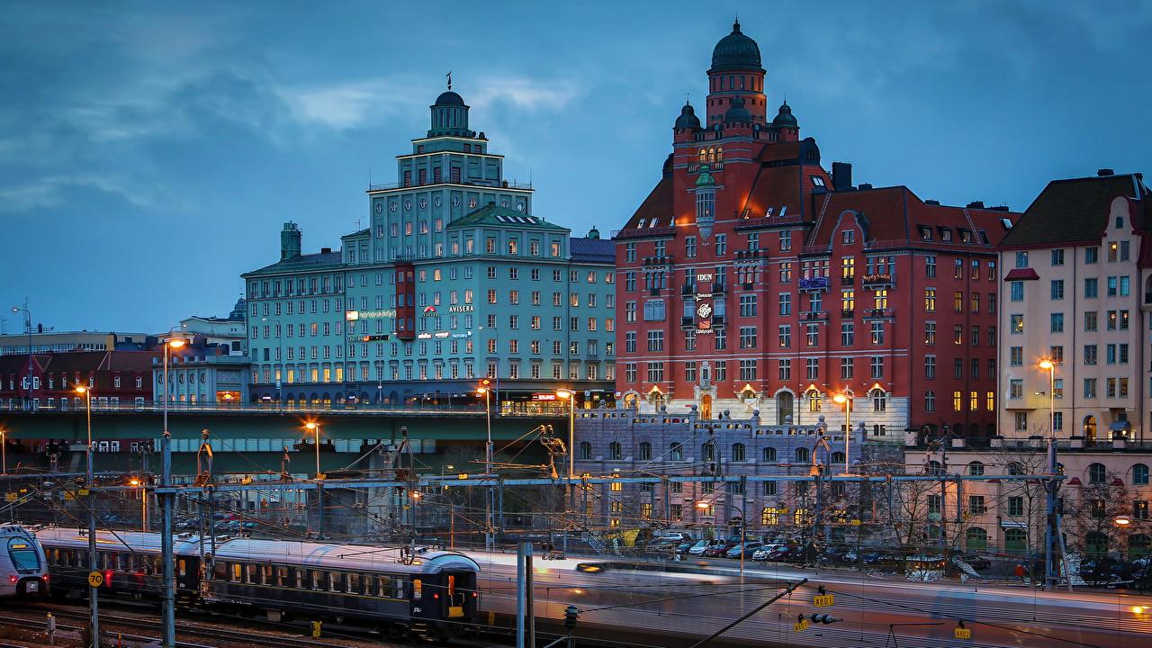 Photo Stockholm Sweden Bridges Trains Evening Street lights Cities Building bridge Houses