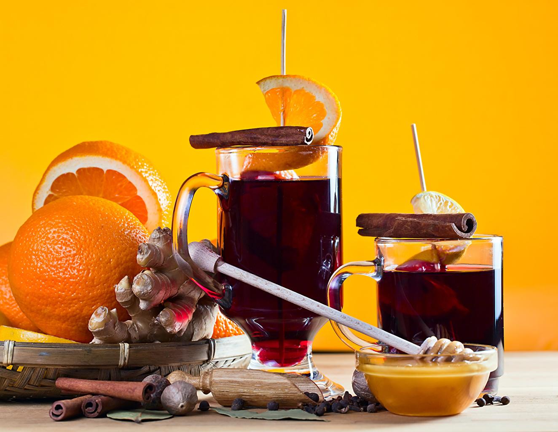 Fotos Mulled wine Ingwer Wein Honig Apfelsine Zimt Becher das Essen Orange Frucht Lebensmittel