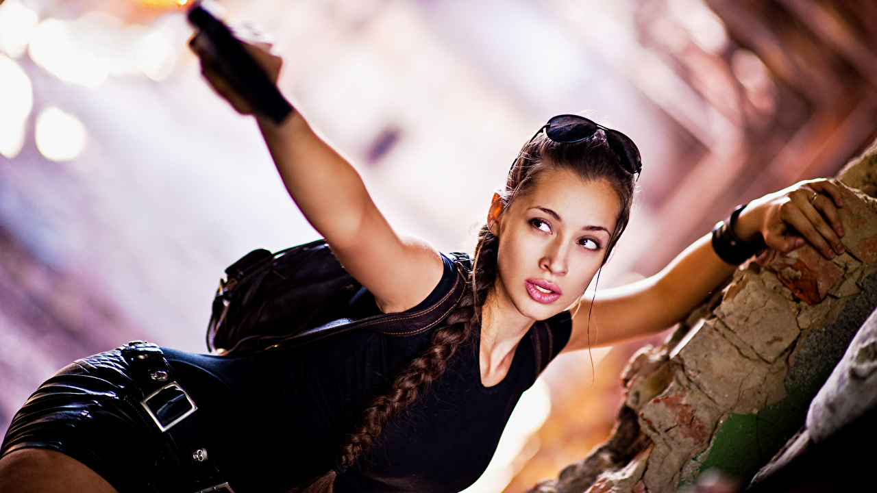 Desktop Wallpapers Lara Croft Braid hair cosplayers blurred background Girls Hands eyeglasses Glance plait Cosplay costume play Bokeh female young woman Glasses Staring