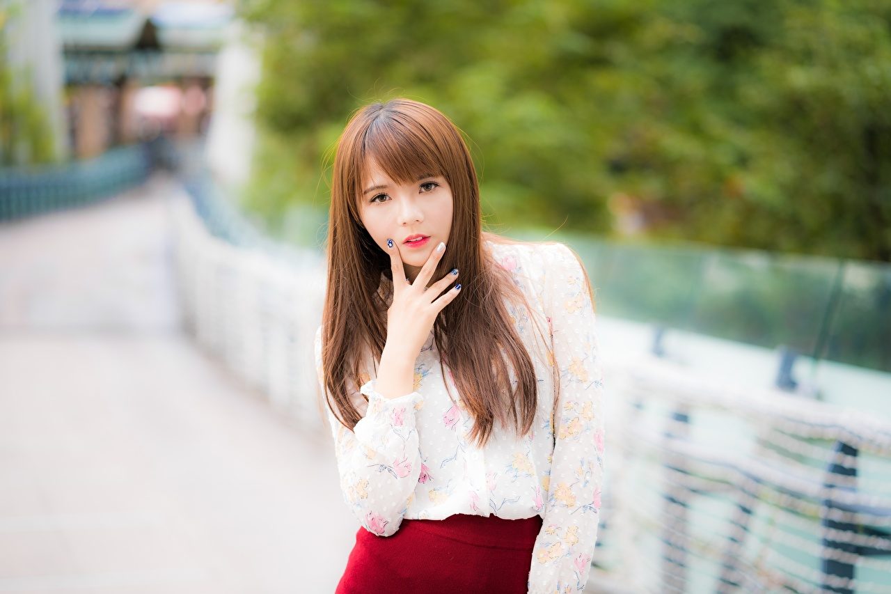 Photo Brown haired blurred background Girls Asiatic Hands Fingers Glance Bokeh female young woman Asian Staring