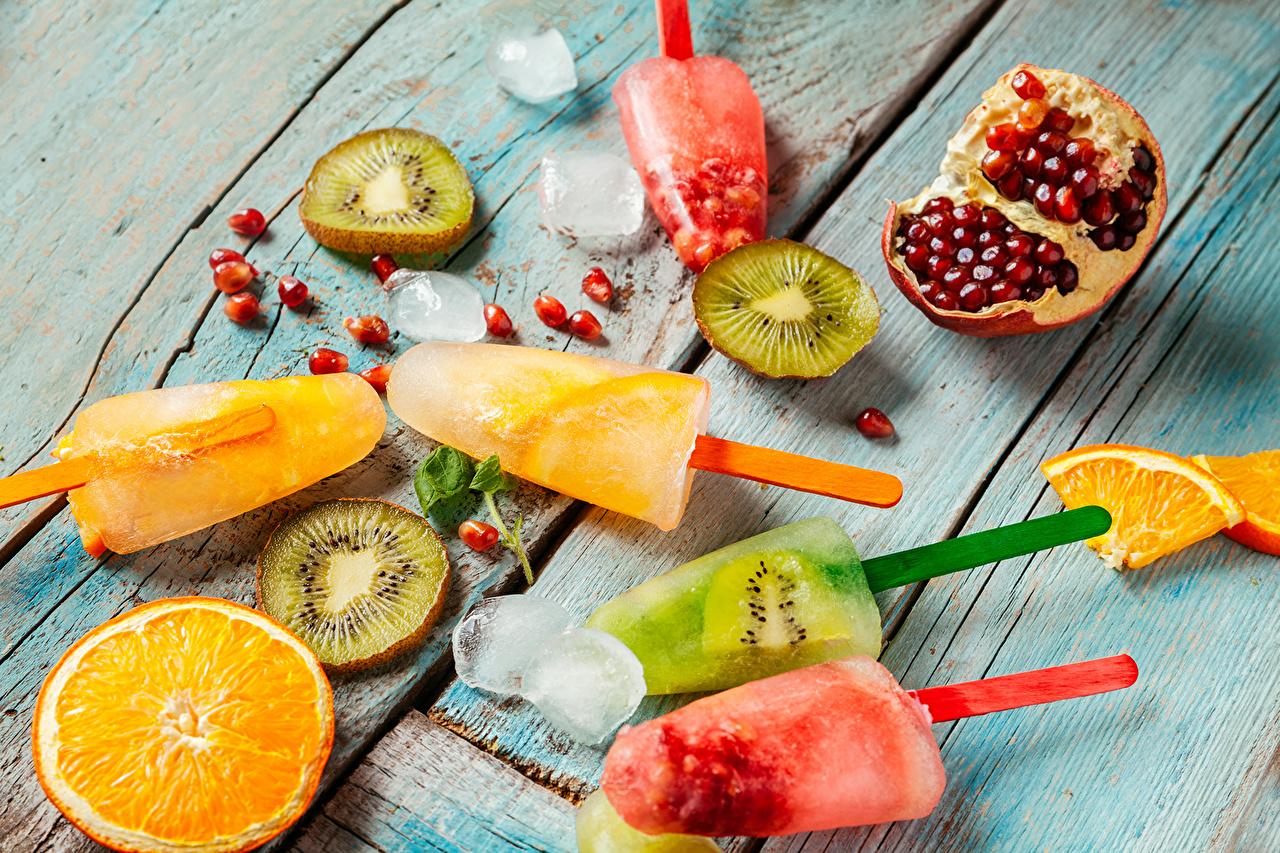 Fotos von Eis Speiseeis Orange Frucht Kiwi Granatapfel Obst Lebensmittel Süßigkeiten Apfelsine Kiwifrucht Chinesische Stachelbeere Süßware