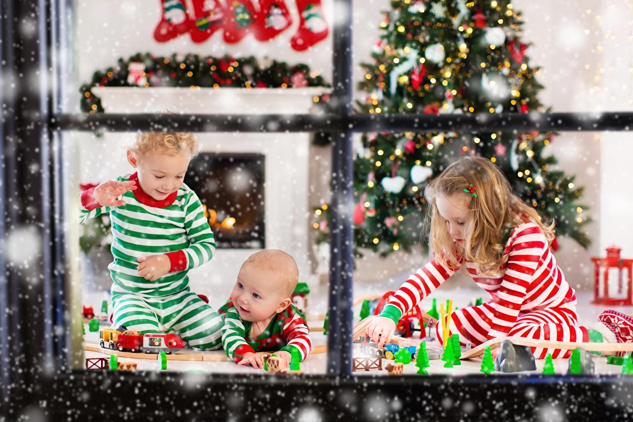 Pictures Little girls Boys newborn New year play child Christmas tree Window Three 3 Baby Infants Christmas Playing Children New Year tree