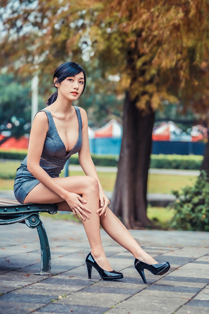 Desktop Wallpapers Brunette girl decollete Girls Legs Asiatic sit Bench Staring Dress Stilettos  for Mobile phone neckline Décolletage female young woman Asian Sitting Glance gown frock high heels
