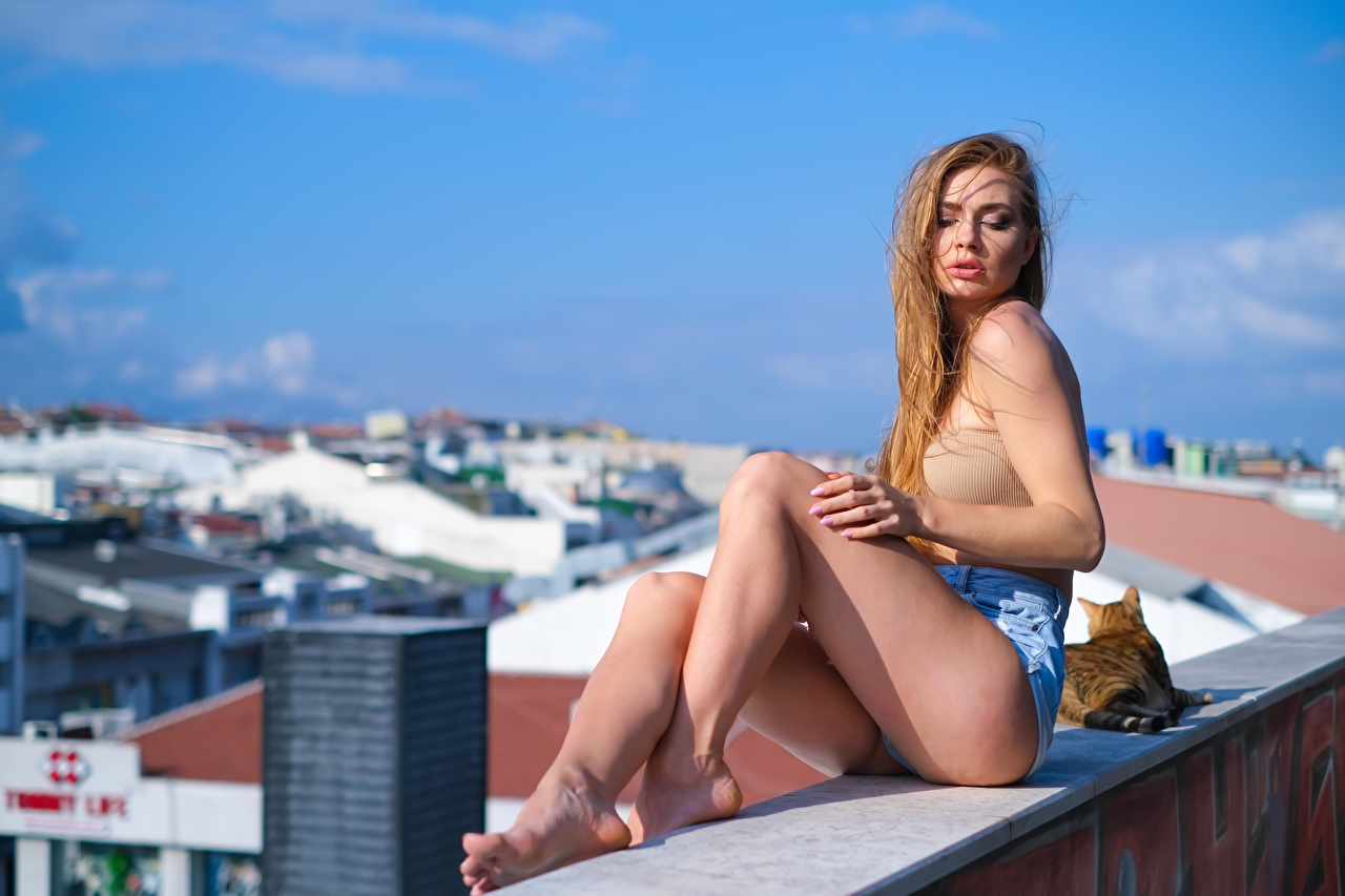 Images blurred background Girls Legs Singlet sit Shorts Bokeh female young woman Sleeveless shirt Sitting