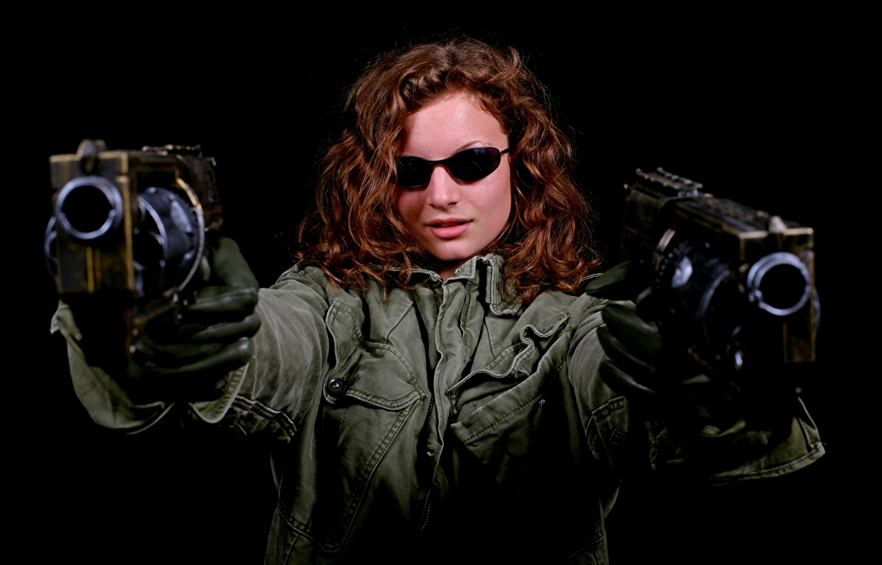 Wallpaper pistol Brown haired Glove Girls Jacket Hands eyeglasses Black background Pistols female young woman Glasses