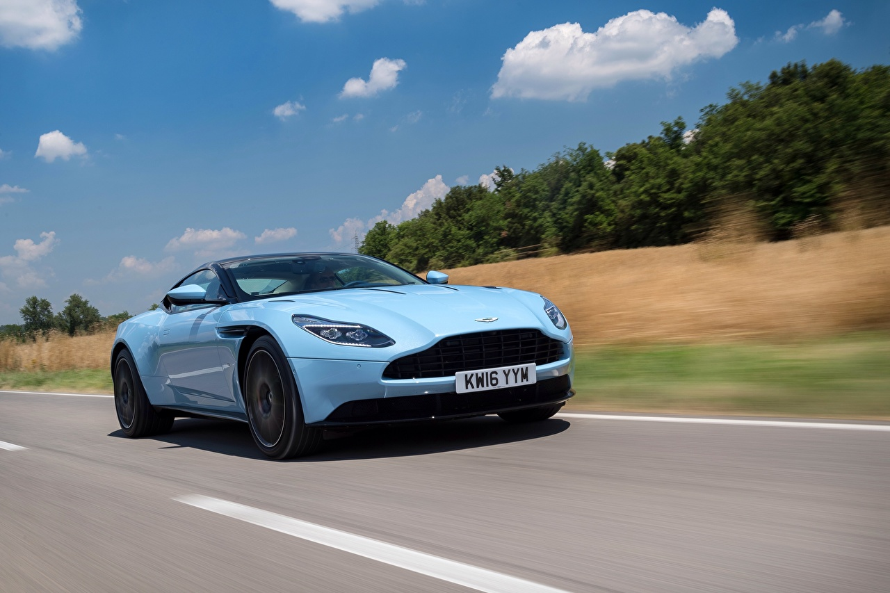 Wallpaper Aston Martin Light Blue at speed automobile moving riding Motion driving Cars auto