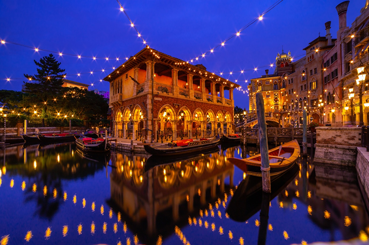 Pictures Tokyo Disneyland Japan Urayasu reflected Boats Water night time Fairy lights Houses Cities Reflection Night Building