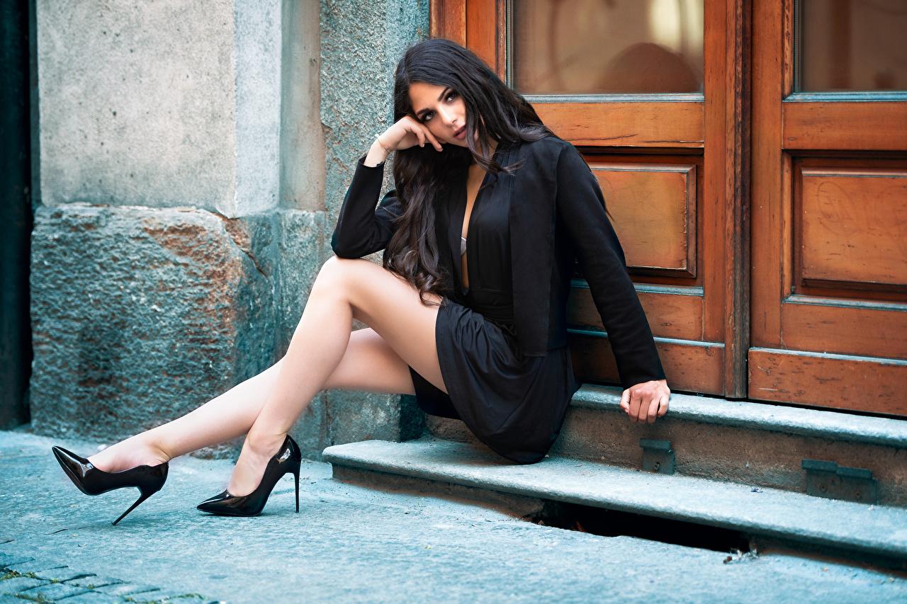 Images Brunette girl Sabrina female Legs Sitting Glance high heels Girls young woman sit Staring Stilettos