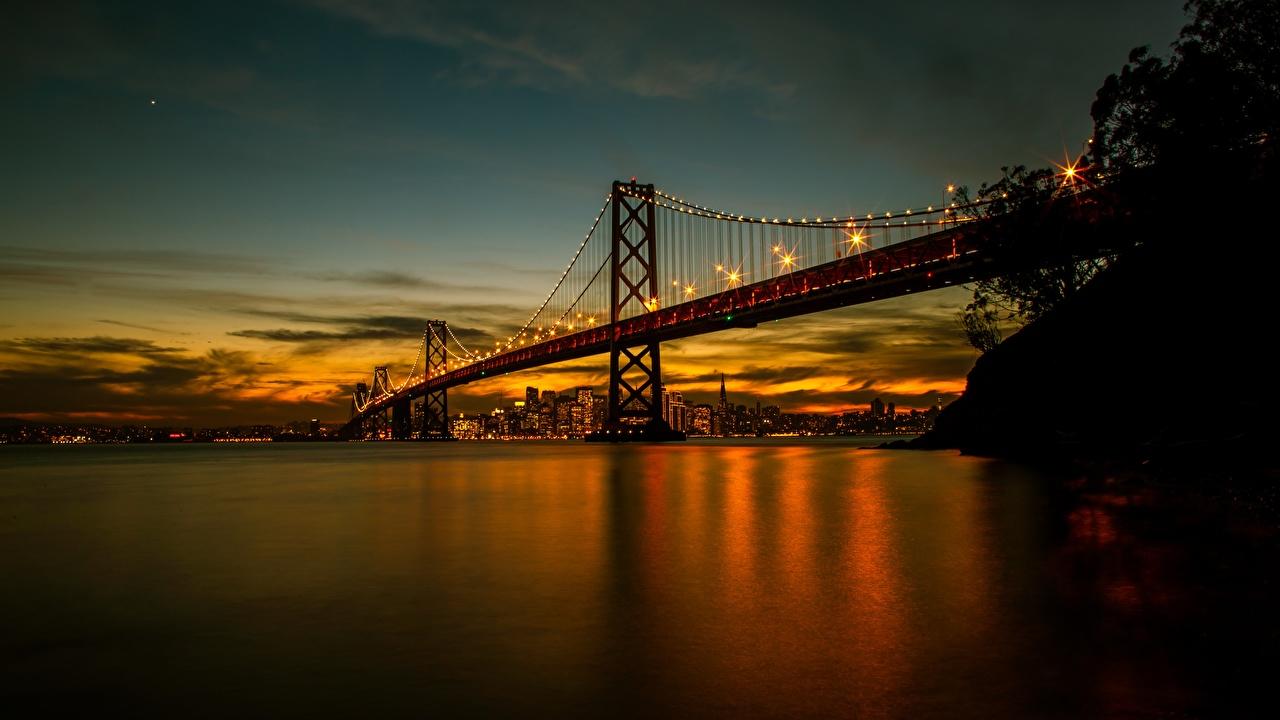 Bilder von San Francisco USA Bay Bridge Brücken Sonnenaufgänge und Sonnenuntergänge Bucht Abend Städte Vereinigte Staaten Brücke Morgendämmerung und Sonnenuntergang