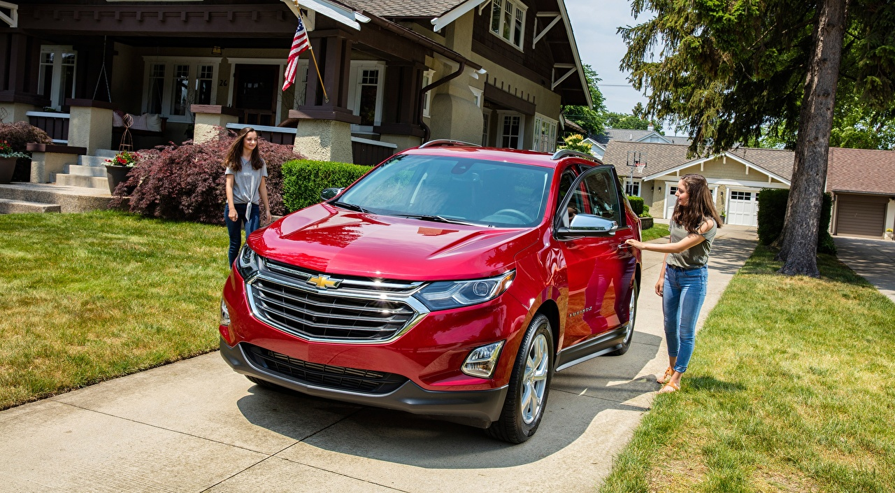 Pictures Chevrolet CUV Equinox, Premier, 2017 Red Girls Cars Front Grass Crossover female young woman auto automobile