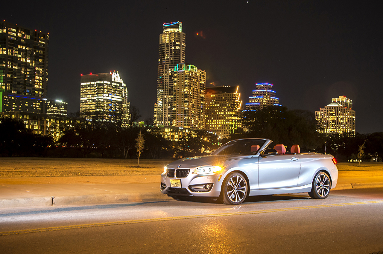 Photos BMW 2015 228i (F23) convertible Cabriolet Silver color Cars Night Houses Cities Convertible auto night time automobile Building