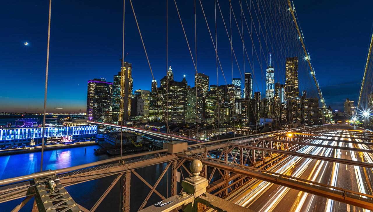 Desktop Wallpapers Manhattan New York City USA bridge river night time Cities Building Bridges Night Rivers Houses