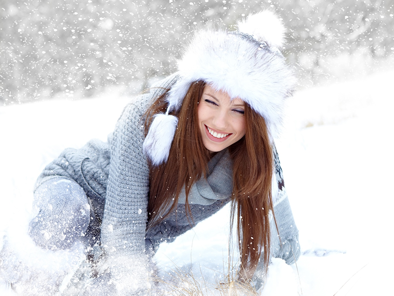 Desktop Wallpapers Izabela Magier Brown haired Smile Girls Winter Winter hat Snow Sweater female young woman