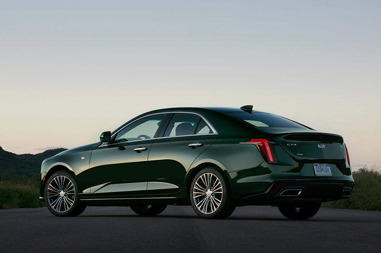Foto Cadillac CT4, 2020 Limousine Grün Seitlich automobil Metallisch auto Autos