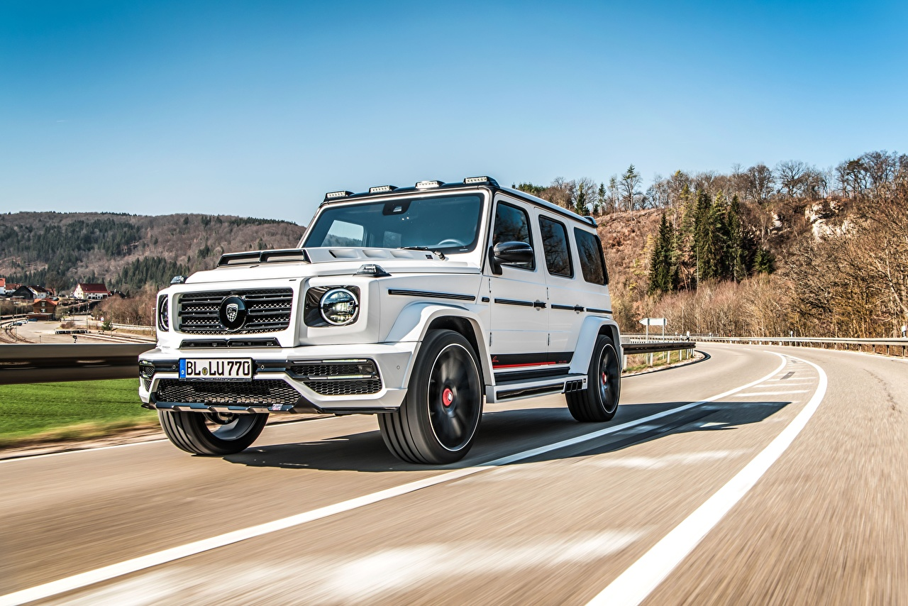 Photo Mercedes-Benz G-Wagen CLR G770 White Motion automobile G-Class moving riding driving at speed Cars auto
