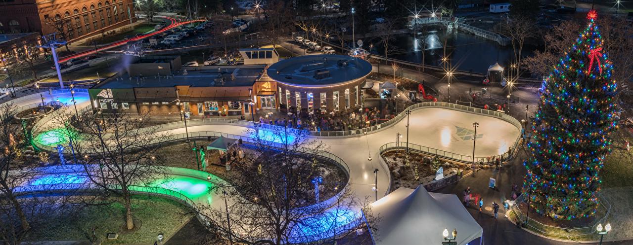 Images USA New year Ice rink Spokane New Year tree Evening Fairy lights Street lights Cities Holidays Christmas Christmas tree
