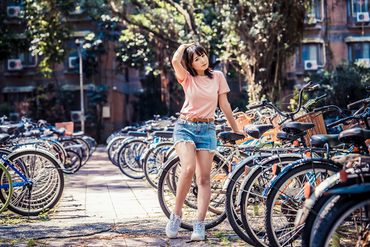 Desktop Wallpapers bicycles T-shirt young woman Asiatic Shorts bike Bicycle Girls female Asian