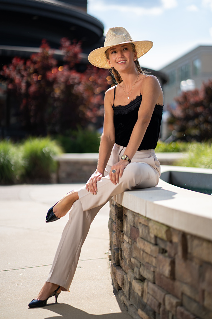 Images Olga Clevenger Sitting Trousers Hat Glance young woman  for Mobile phone sit pants Girls female Staring