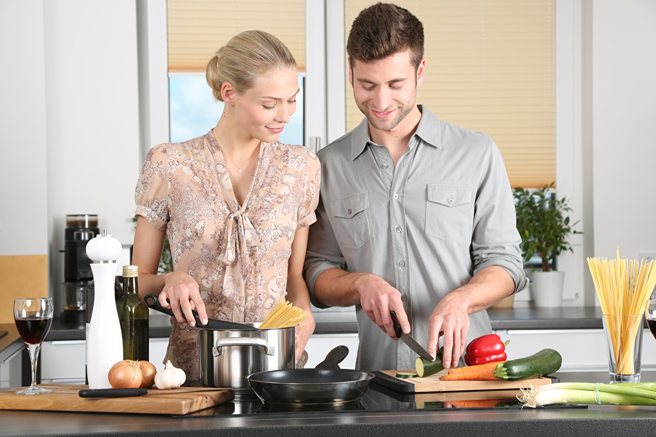 Photo Kitchen Blonde girl Man Knife Two female Frying pan Stemware Cutting board Men 2 Girls young woman frypan
