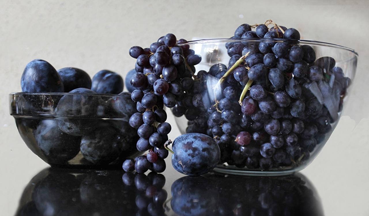Photo Plums Grapes Food Gray background