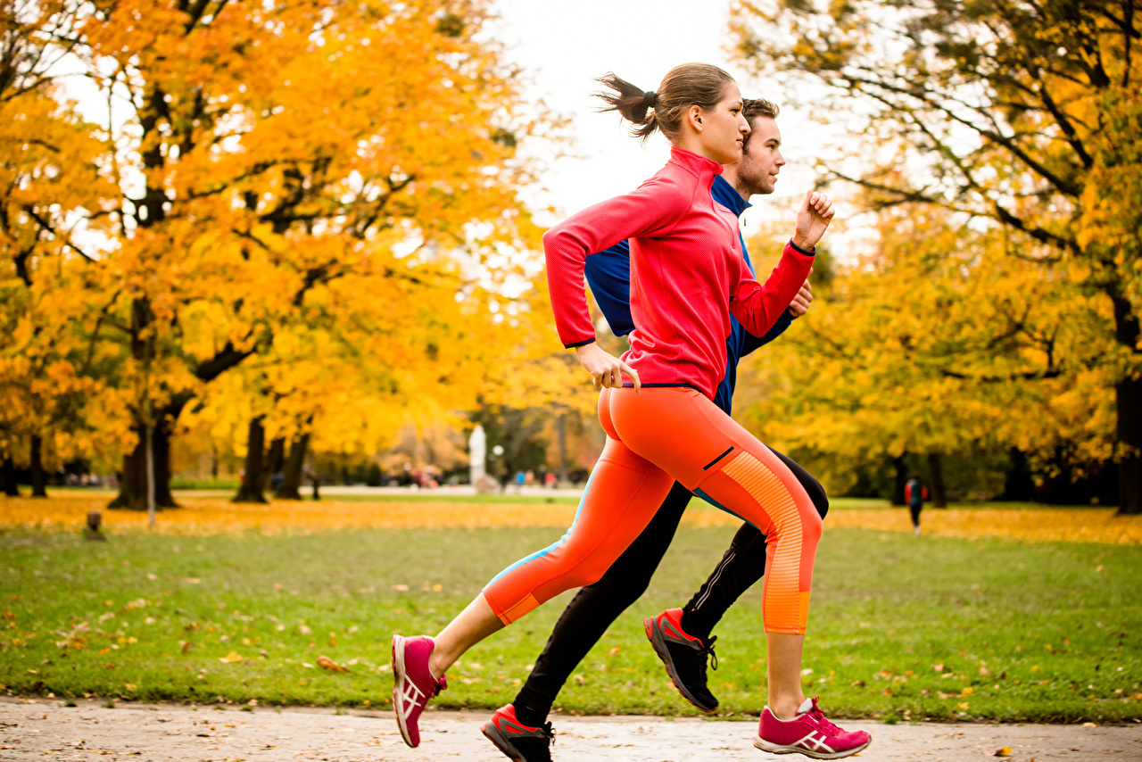 Pictures Brown haired Man Running Fitness 2 Autumn young woman Men Run Two Girls female