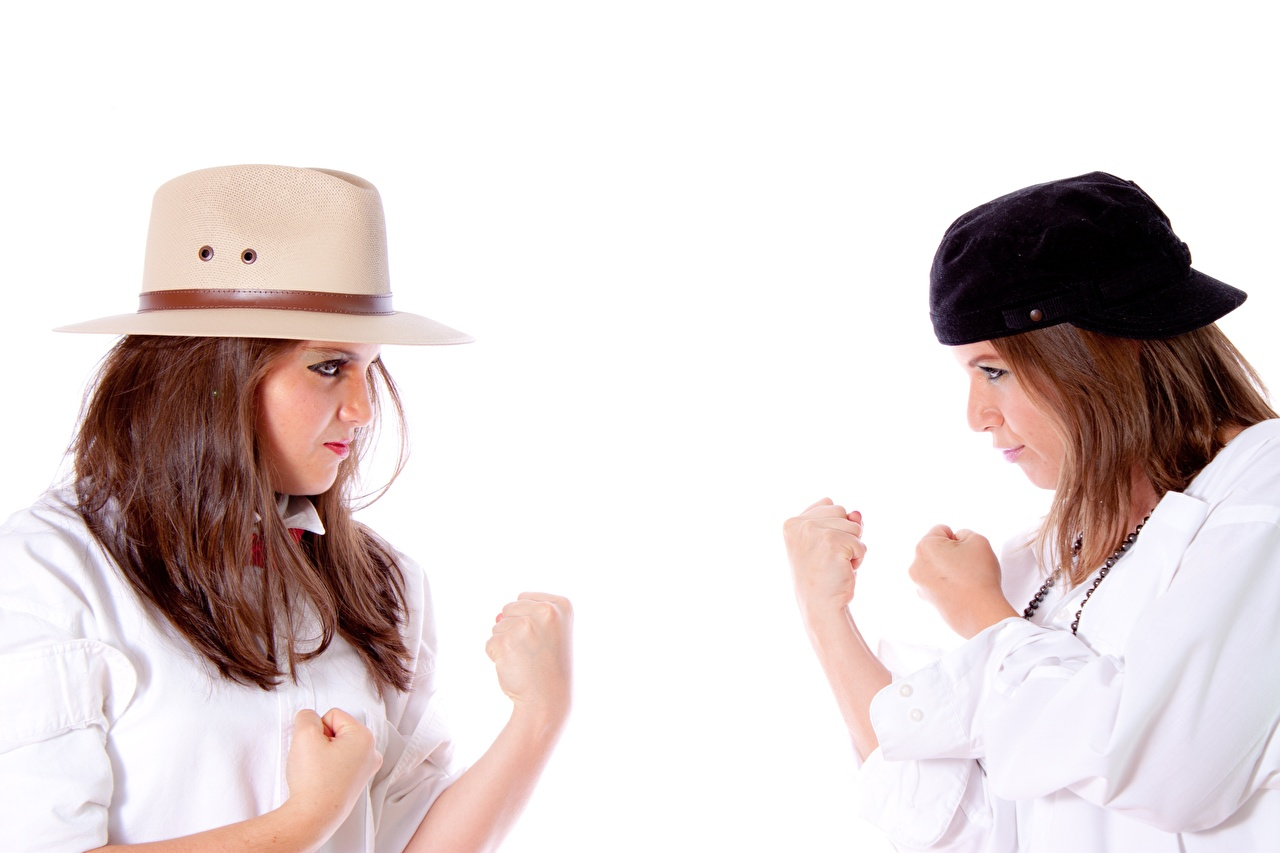 Pictures Brown haired Pose Two Hat Girls Fight Hands White background posing 2 female young woman