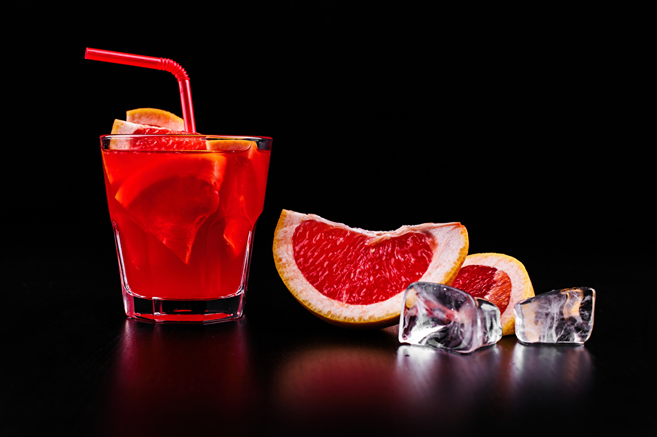 Pictures Alcoholic drink Ice Grapefruit Food Cocktail Shot glass Black background Mixed drink