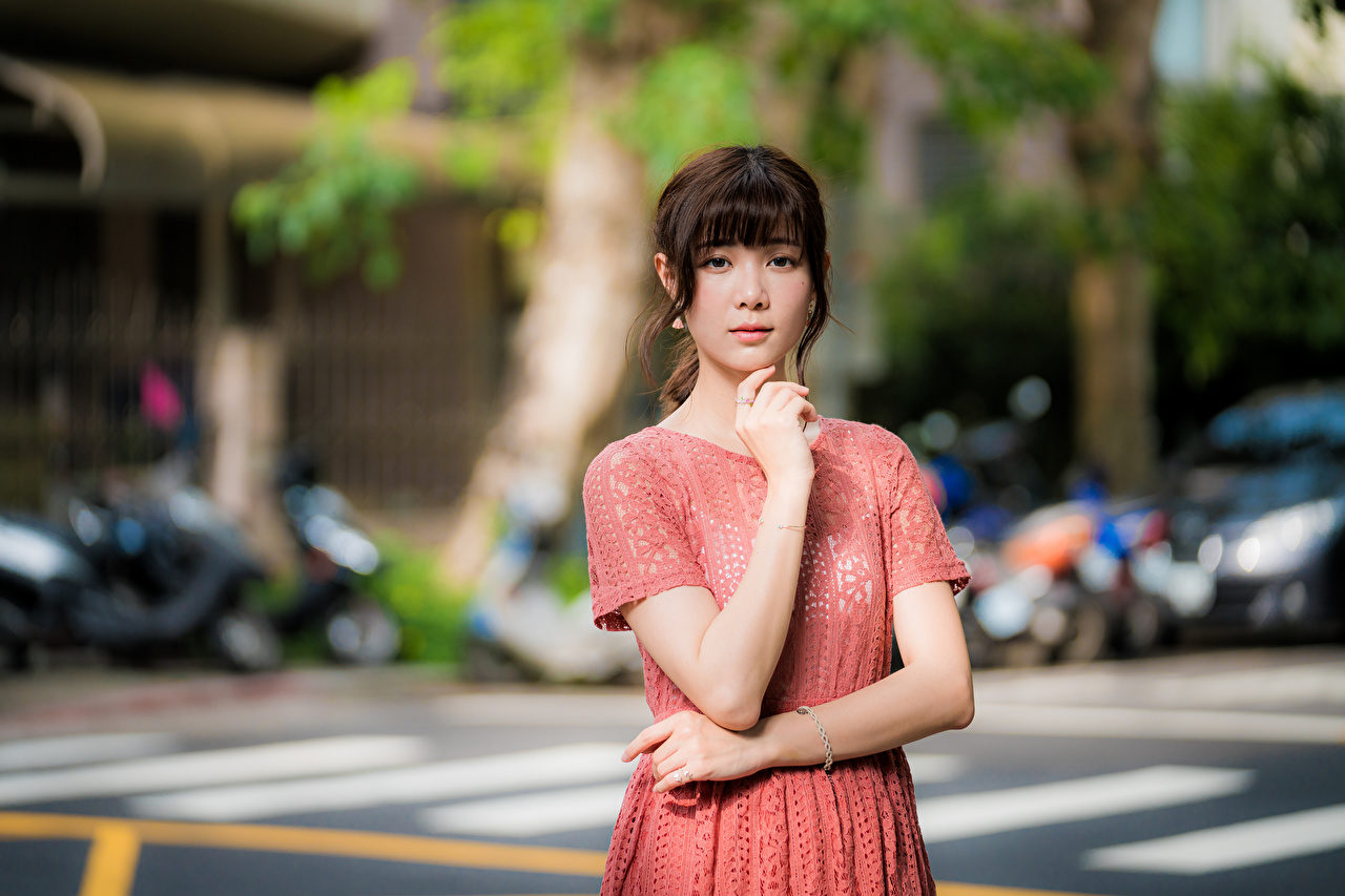 Photos Bokeh posing young woman Asiatic Hands Glance Dress blurred background Pose Girls female Asian Staring gown frock