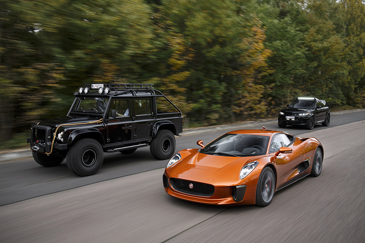 Photos Jaguar 2015 C-X75 Spectre Orange moving Cars Three 3 Metallic Motion riding driving at speed auto automobile