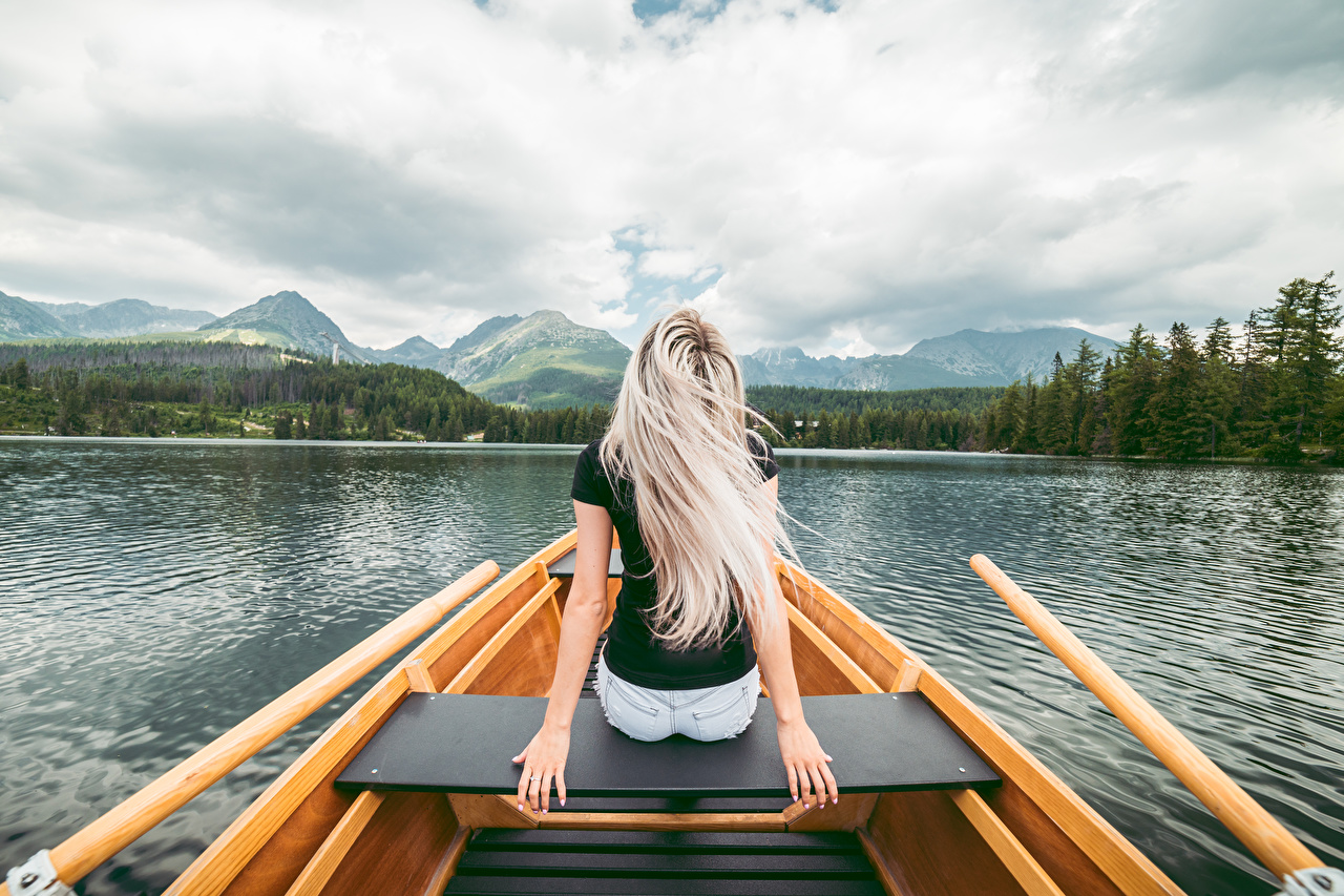 Photos Blonde girl Girls Lake sit Boats Hands Back view female young woman Sitting