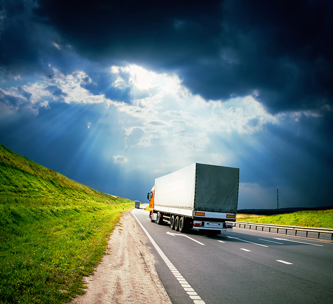Photos Rays of light lorry Roads Cars Back view Clouds Trucks auto automobile