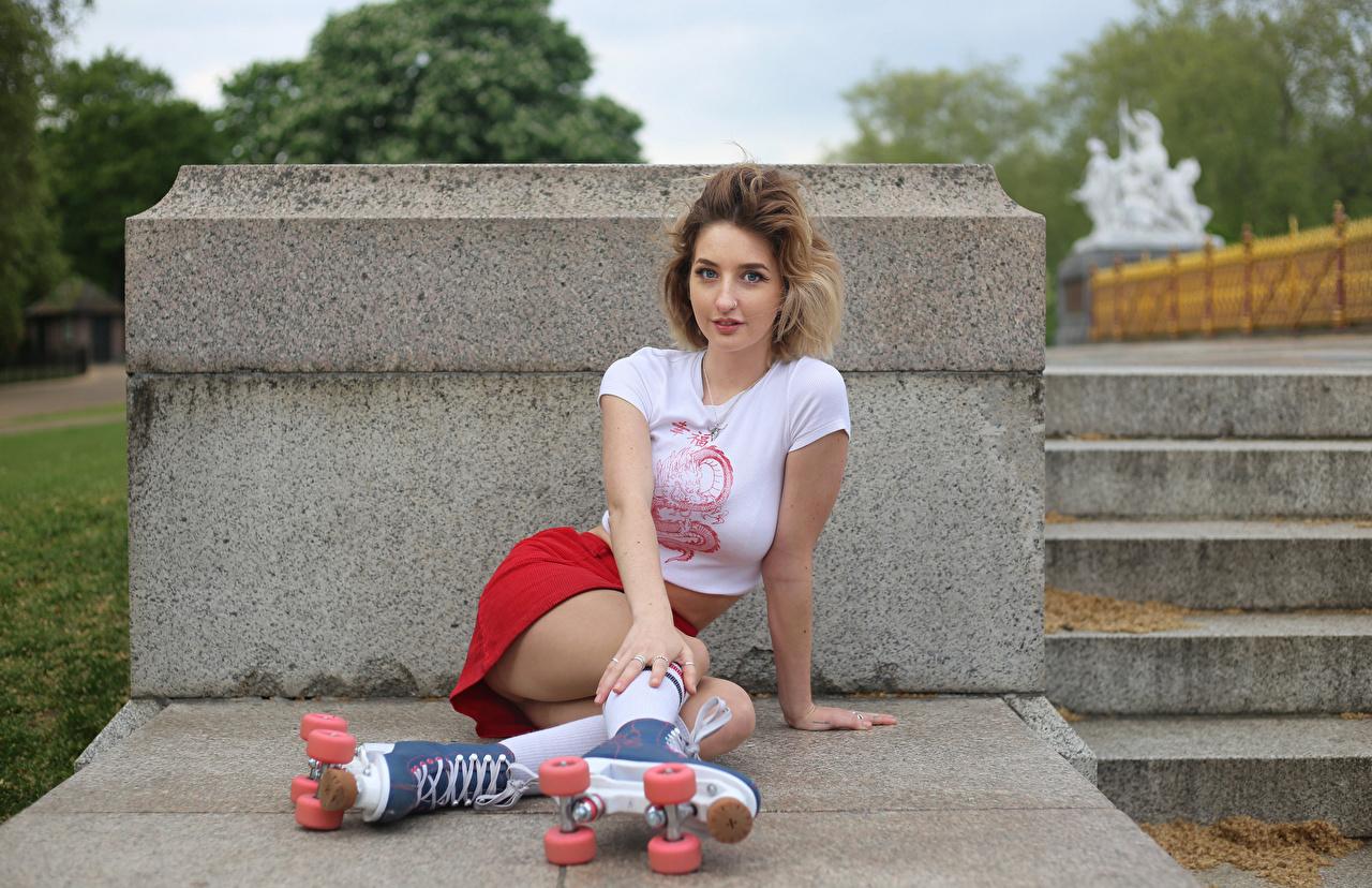 Photo Skirt Georgia female T-shirt Roller skates Legs Sitting Glance Girls young woman sit Staring
