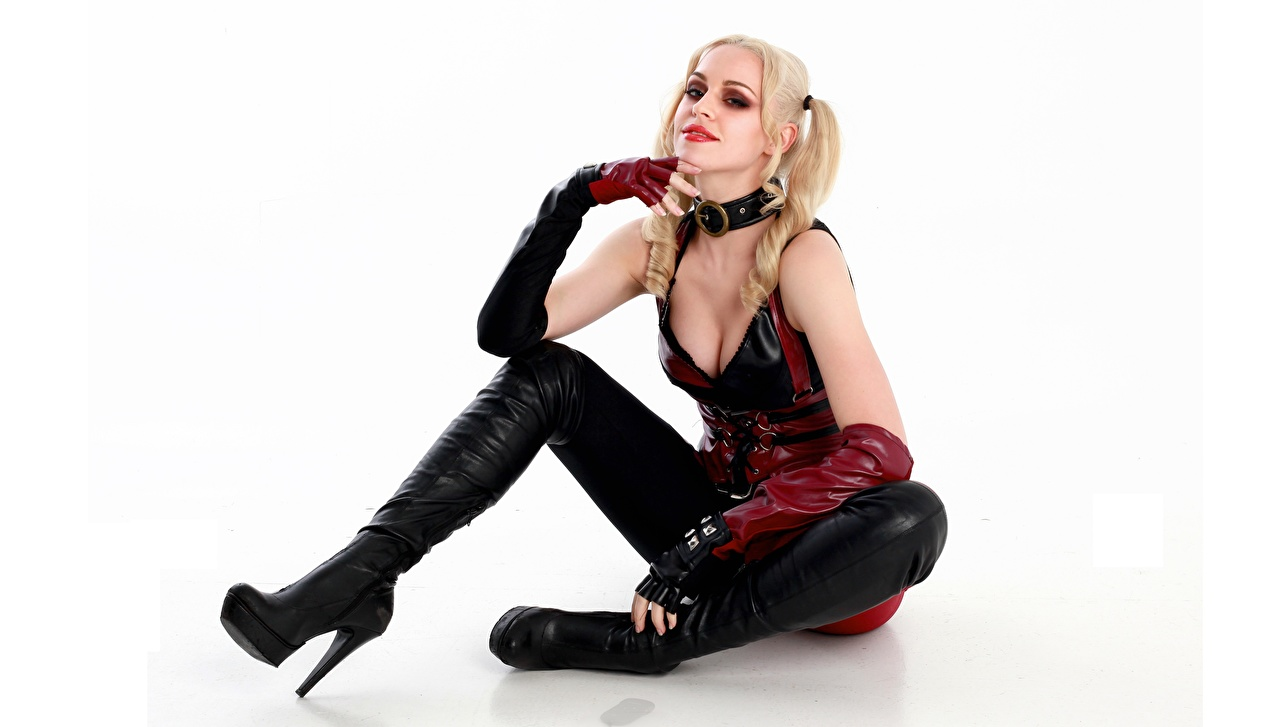 Photo young woman Sitting cosplayers Harley Quinn hero iStripper White background Hands Latex Blonde girl Legs Girls female sit Cosplay costume play