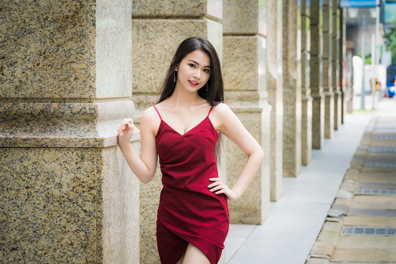 Photos Brunette girl blurred background posing Girls Asiatic Hands frock Bokeh Pose female young woman Asian gown Dress