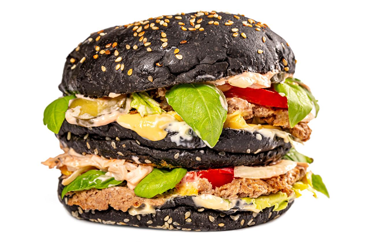 Foto Burger Schwarz Brötchen Gemüse Lebensmittel Fleischwaren Großansicht Weißer hintergrund Hamburger das Essen hautnah Nahaufnahme