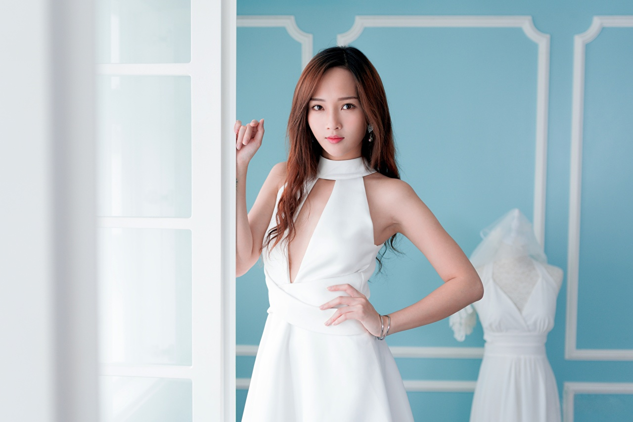 Photos Brown haired blurred background female Asiatic Hands Glance frock Bokeh Girls young woman Asian Staring gown Dress