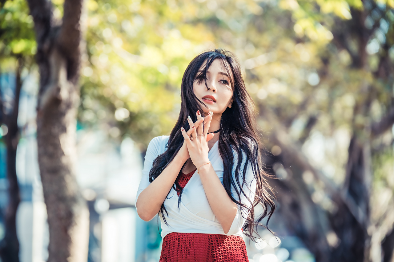 Image Brunette girl blurred background Girls Asian Hands Staring Bokeh female young woman Asiatic Glance