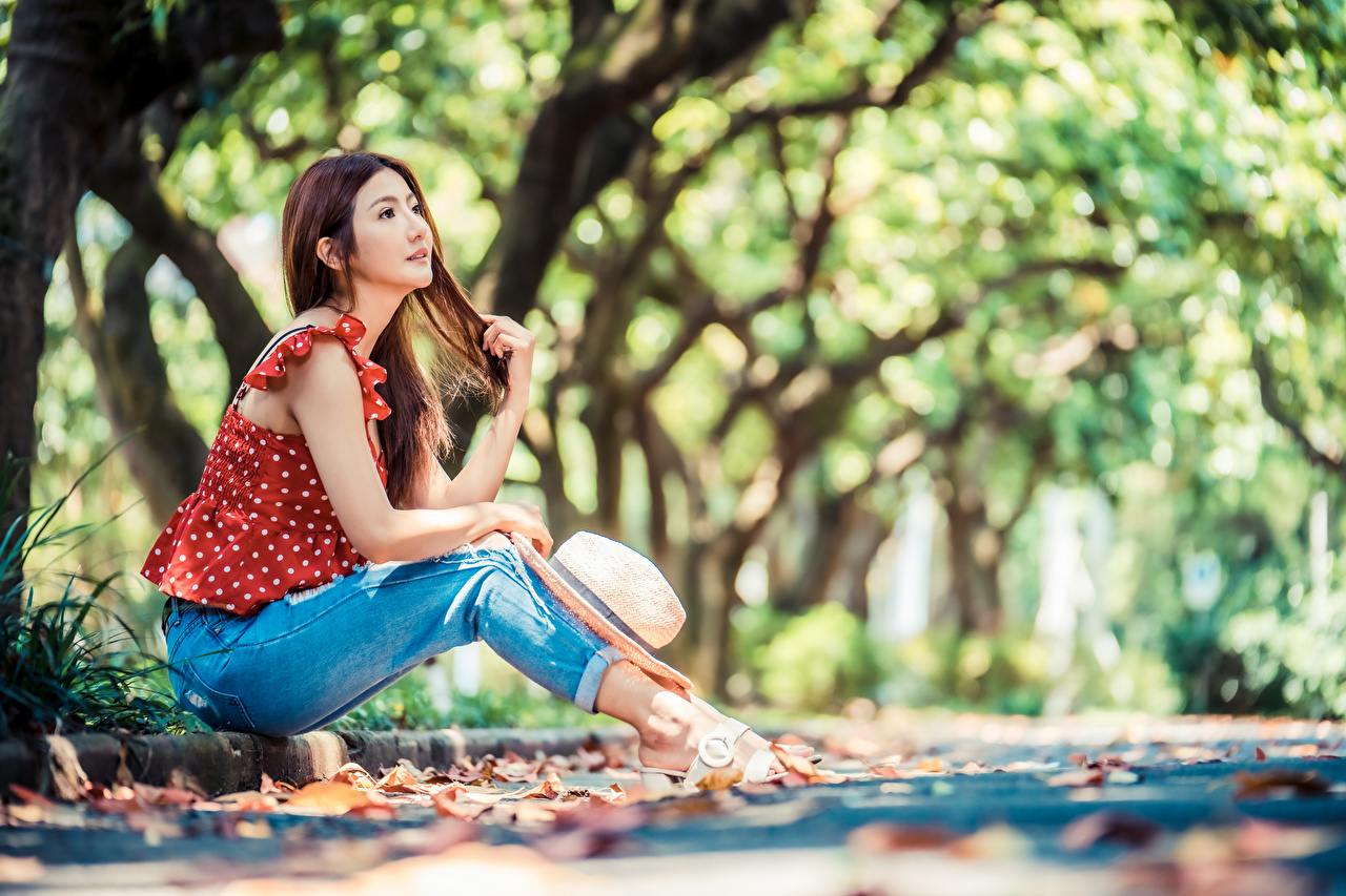 Images Bokeh Blouse Hat Girls Asian Jeans sit blurred background female young woman Asiatic Sitting
