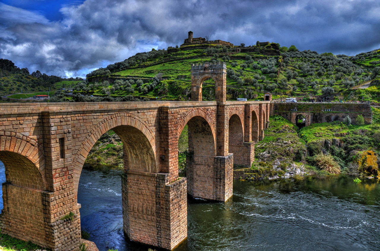Photo Spain Alcantara Bridge, Tagus river, province Caceres HDRI Nature Bridges Hill river HDR bridge Rivers