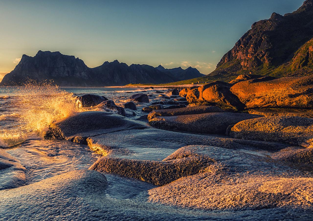 Images Lofoten Norway Cliff Nature Water splash Sunrises and sunsets Bay Coast Crag Rock sunrise and sunset