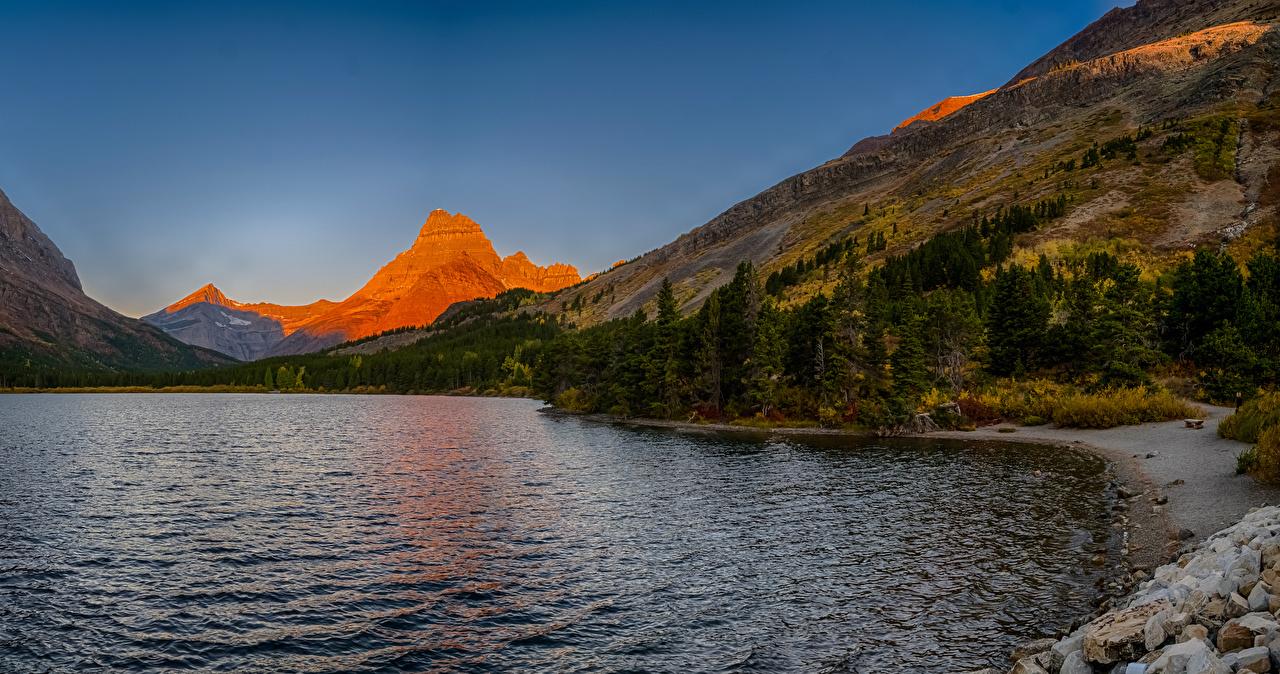 Desktop Hintergrundbilder USA Swiftcurrent Lake Montana Natur Gebirge See Wald Vereinigte Staaten Berg Wälder
